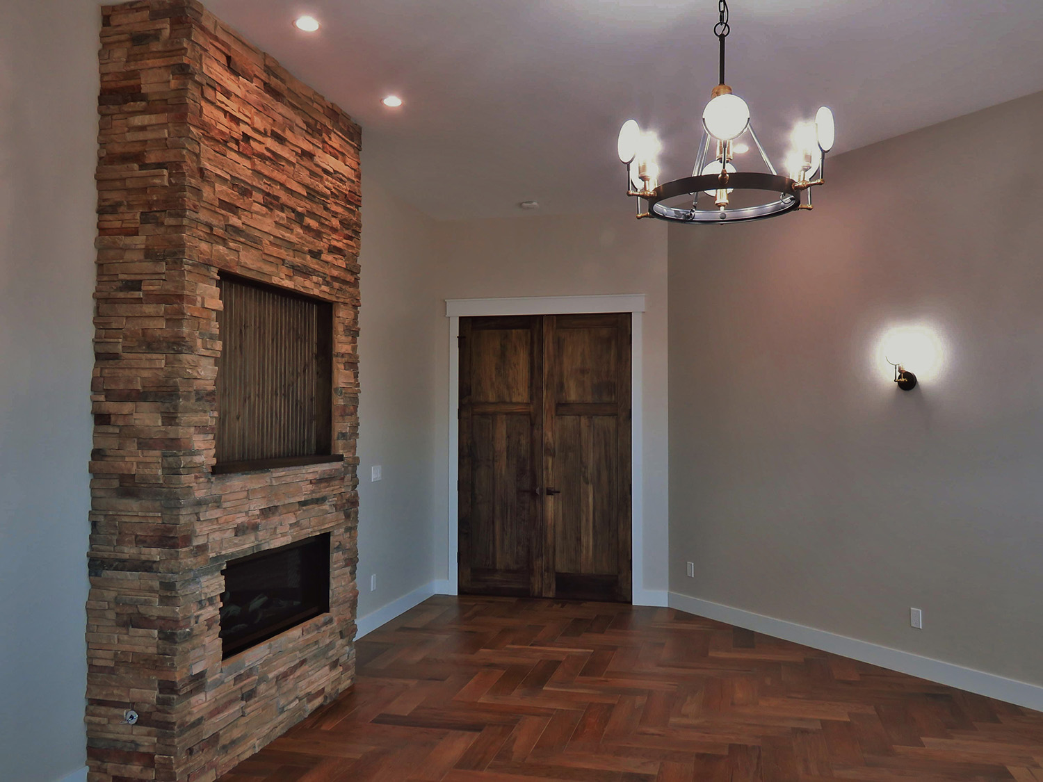 thick wooden doors and stone fireplace